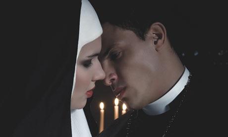 woman kisses priest, woman kisses preacher at pride, pride preacher kiss arrested, woman arrested kissing preacher