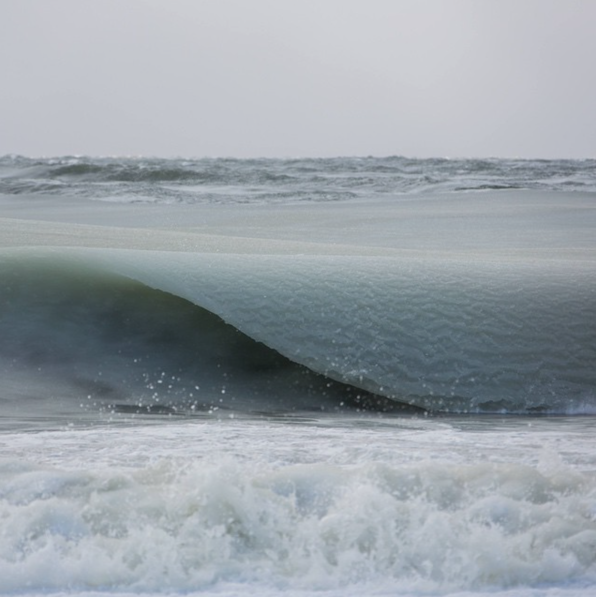 """Jonathan Nimerfroh based in Nantucket, Massachusetts. captured rare """"slurpee"""" waves, that were so cold they rolled in as slush."""