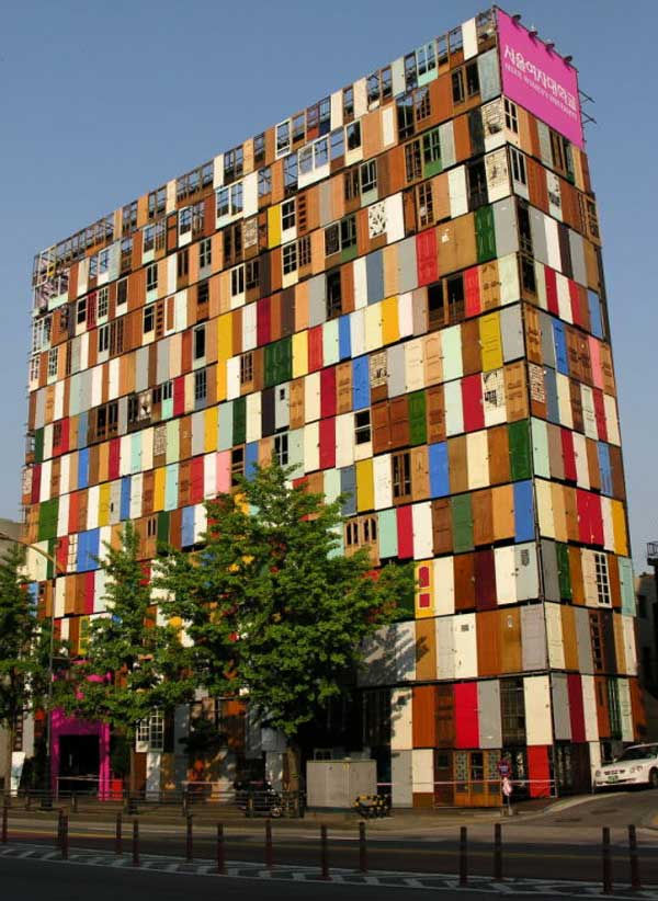 South Korean Artist Choi Jeong-Hwa used 1000  doors on scaffolding to turn a ten-story building in downtown Seoul, Korea into a public work of art.
