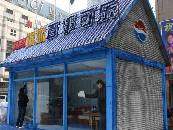 A small shop in Nanjing, China constructed out of 100,000 Pepsi cans.