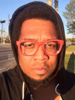 Chaaz Quigley, Black, activist, writer, glasses, queer, LGBT, Dallas