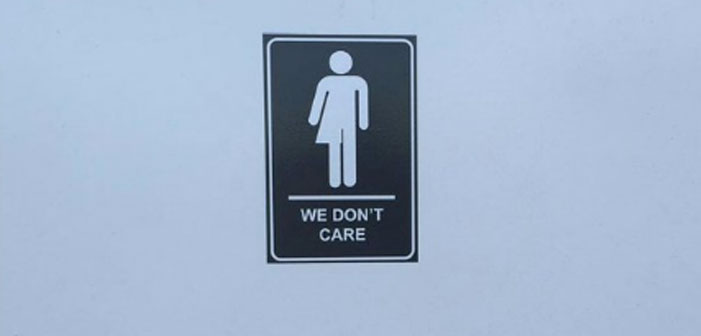 Artist Fights Transphobia with Gender-Fluid 'We Don't Care' Restroom Sign