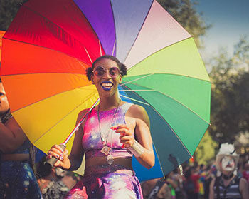 Orlando, Pride, Florida, Come Out With Pride, LGBT, gay, lesbian, rainbow umbrella, parade, girl, Black, woman
