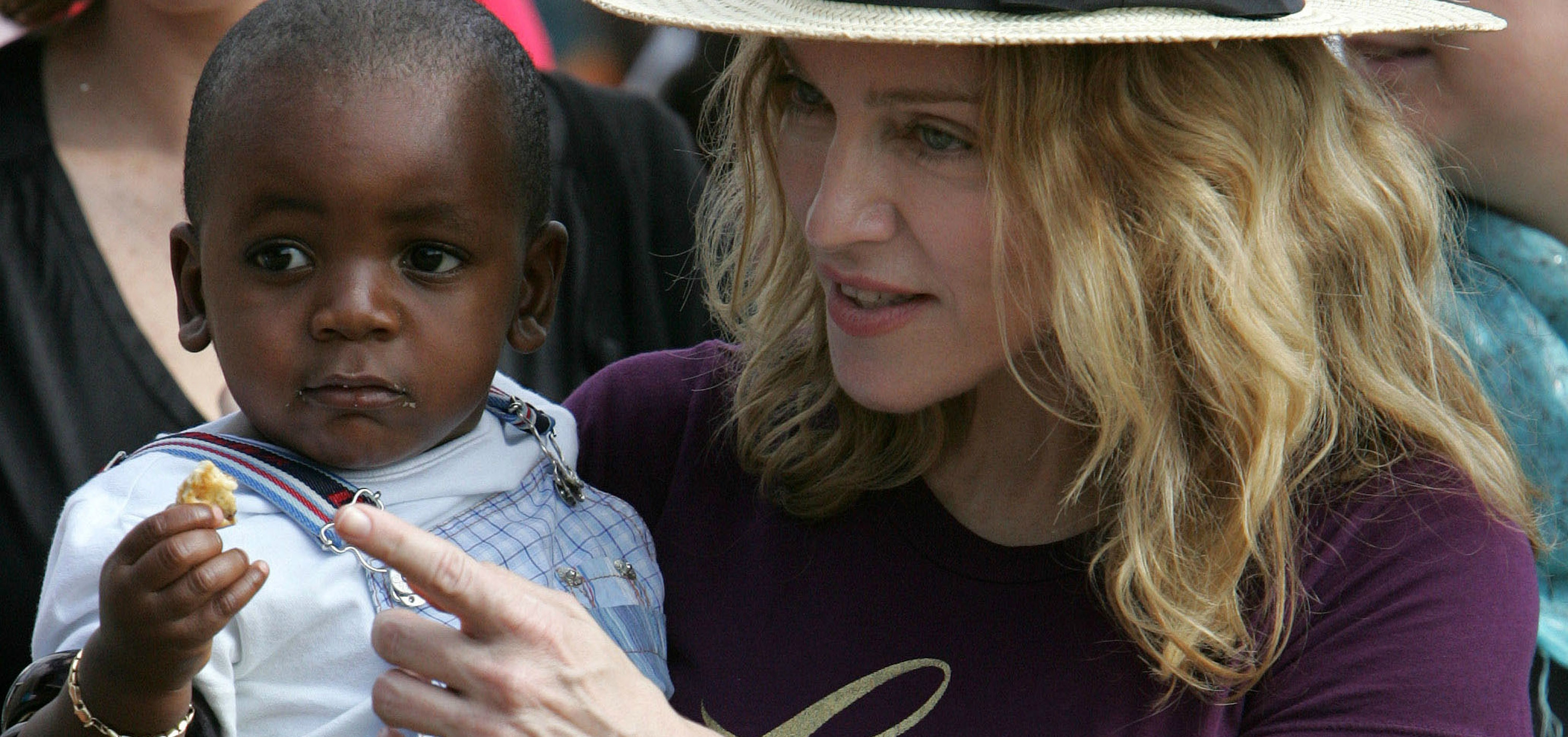 Despite Uncomfortable Questions, Madonna Adopts Twins from Malawi
