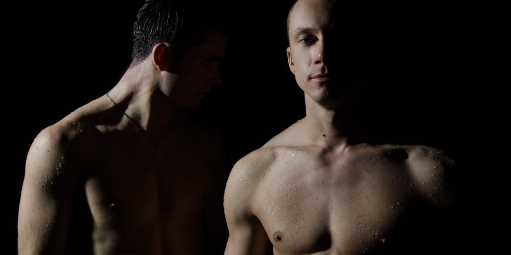 Two handsome guy posing in the studio. Gender issues.