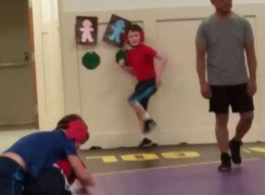 kid dancing at wrestling practice