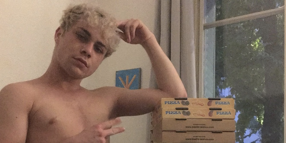 This Frequently Topless Guy Built His Own Chair Out of Pizza Boxes