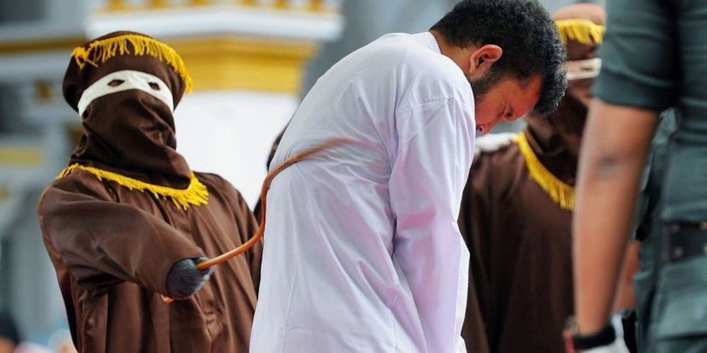 An Indonesian Crowd Cheers While Two Men Are Publicly Caned for Having Gay Sex