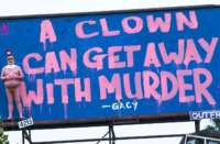 naked trump clown billboard feat
