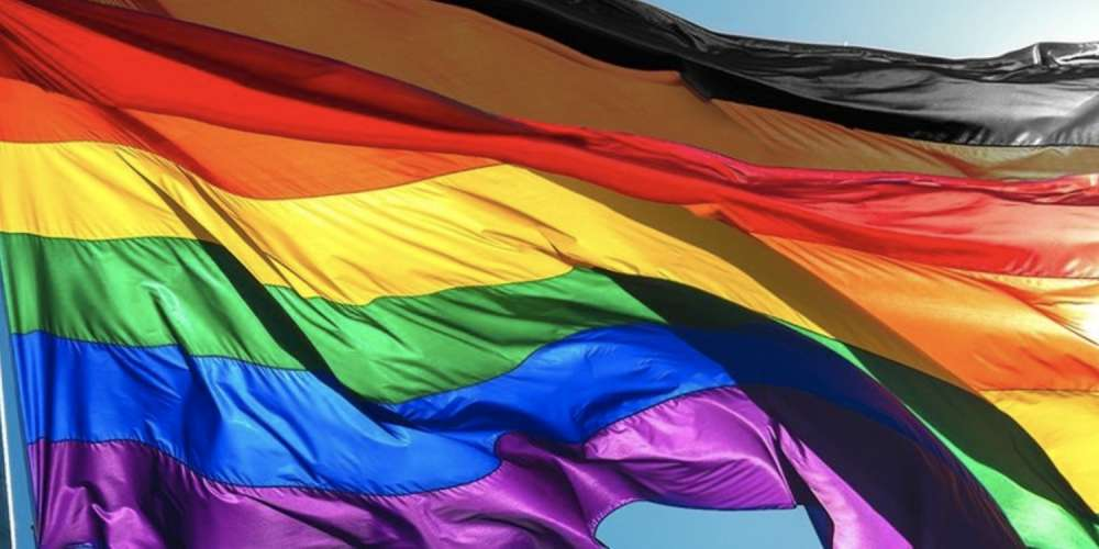 Manchester Pride Has Officially Adopted This 'Controversial' Rainbow Flag With 2 Extra Stripes